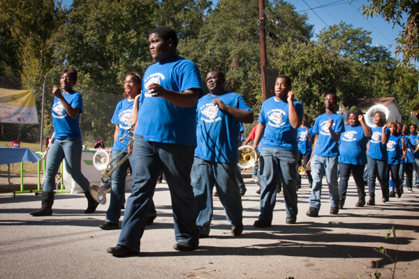 Youth marching during the Festival of Lights parade in Atlanta's Westside