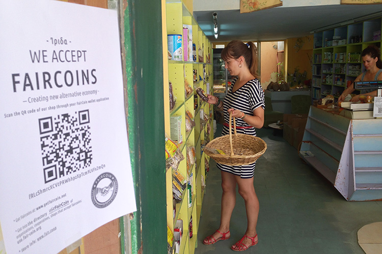 Shopping with Fair Coins, a solidarity-based cryptocurrency