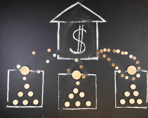 A picture of money moving schematically on a chalkboard to indicate the concentration of wealth in a financial institution.