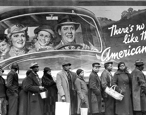 "Line of African Americans under billboard picturing smiling happy white people, with text reading ""There's no way like the American way"""