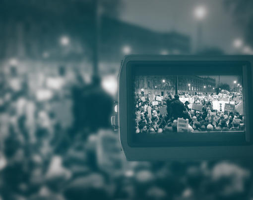 a clear image of a protest is scene through the lens of a camera