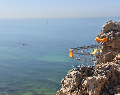 Shopping Cart Perched on Cliff