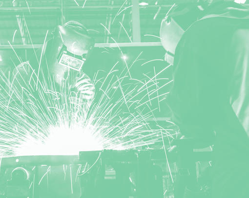 Workers welding, with exciting sparks flying!