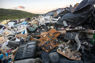 A landfill overflowing with discarded consumer goods.
