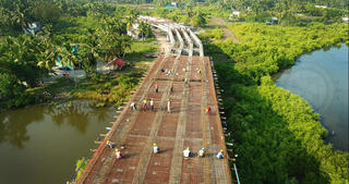 A road being built across a river