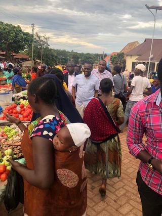 ACT elected officials, local councilors and MP Zitto Kabwe, visiting the solar-powered night market in Kigoma Town.