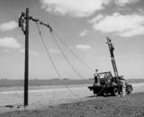 Rural Electrification Administration erects telephone lines in rural areas.