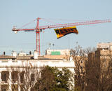"A banner reading ""Resist"" flying from a crane over the White House"
