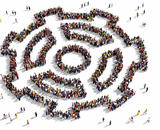 People assembled to form the outlines of a large gear