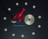 Abstract elements surrounding a lobster, a CD, and other signifiers of potential commons.
