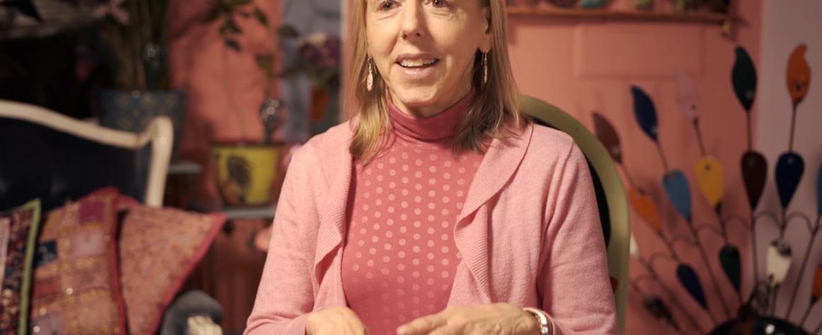A picture of Medea Benjamin, wearing pink.