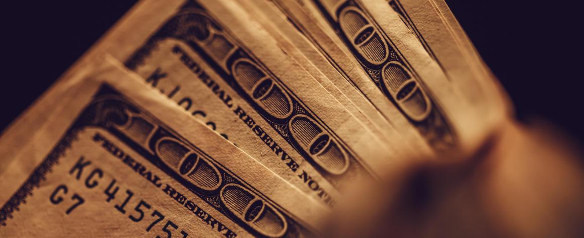 Hundred dollar bills in the shadows