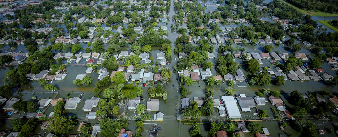 Aerial photo of many flooded houses in Houston after Hurricane Harvey.